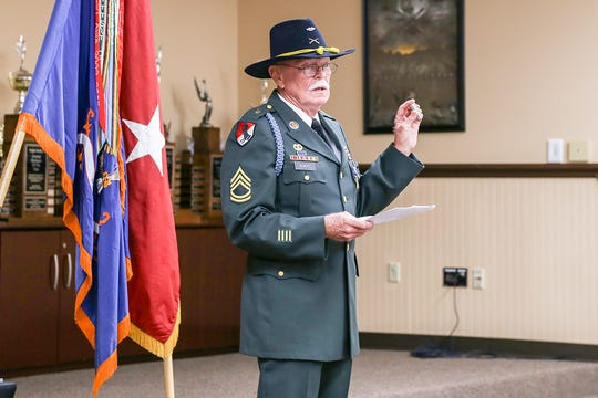 """Retired Army Sergeant First Class Wilford """"Mike"""" DeNote holds a Zippo lighter that he carried with him throughout his tour of duty during the Vietnam War. DeNote received a Silver Star on Aug. 30 for his actions during a battle in September 1970."""