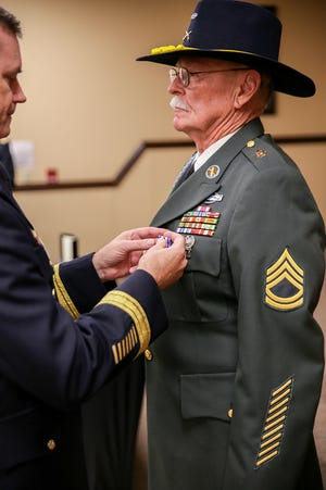 """Retired Army Sergeant First Class Wilford """"Mike"""" DeNote is awarded the Silver Star for his actions during the Vietnam War in 1970."""