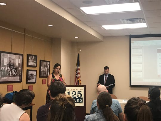 UT doctoral student Melanie Barron speakers at a public hearing for Rohm and Haas' renewal permit for storing hazardous waste at its Dale Avenue plant. Barron, a former resident of Fort Sanders, is concerned about the impact of chemical byproducts on residents of the neighborhood.