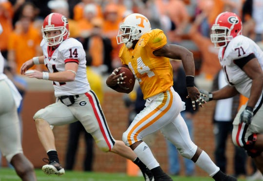 Tennessee cornerback Eric Berry (14) returns an interception/fumble return 46-yards with Georgia quarterback Joe Cox (14) and offensive tackle Cordy Glenn (71) in pursuit on Saturday, Oct. 10, 2009 at Neyland Stadium.