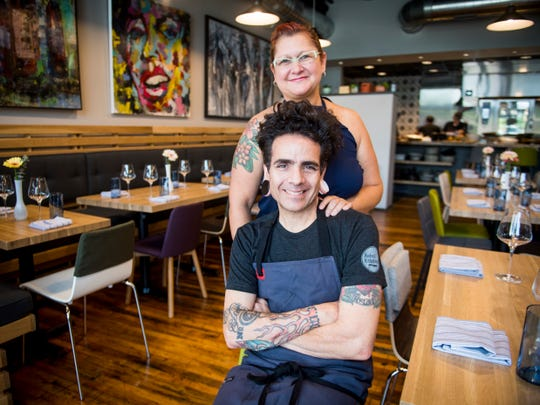 Chef Paul Sellas and his wife Franchesca Sellas inside Rebel Kitchen, a new restaurant at 108 W. Jackson Avenue in Knoxville's Old City.