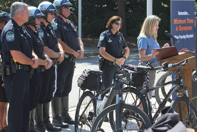 Amy Johnson (right), a Tennessee attorney for the Bike Law Network, speaks during the unveiling of C3FT devices at World's Fair Park on Sept. 20, 2018.,