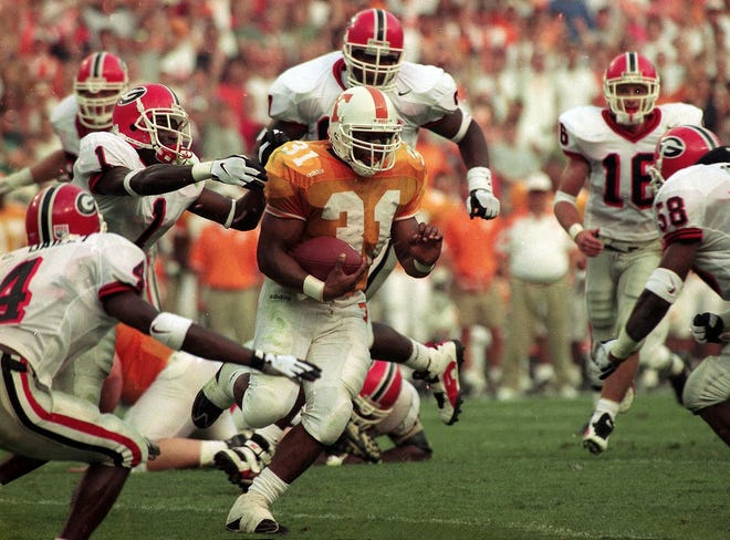 Tennessee's Jamal Lewis is surrounded by Georgia defenders on October 12, 2997. (Michael Patrick/News Sentinel)