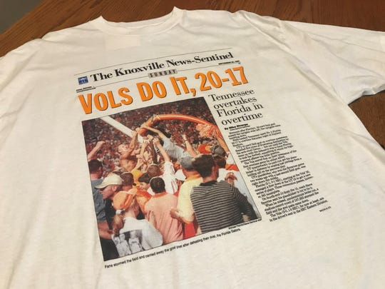 A replication of the News Sentinel's front page of the 1998 win against Florida is displayed on a t-shirt.