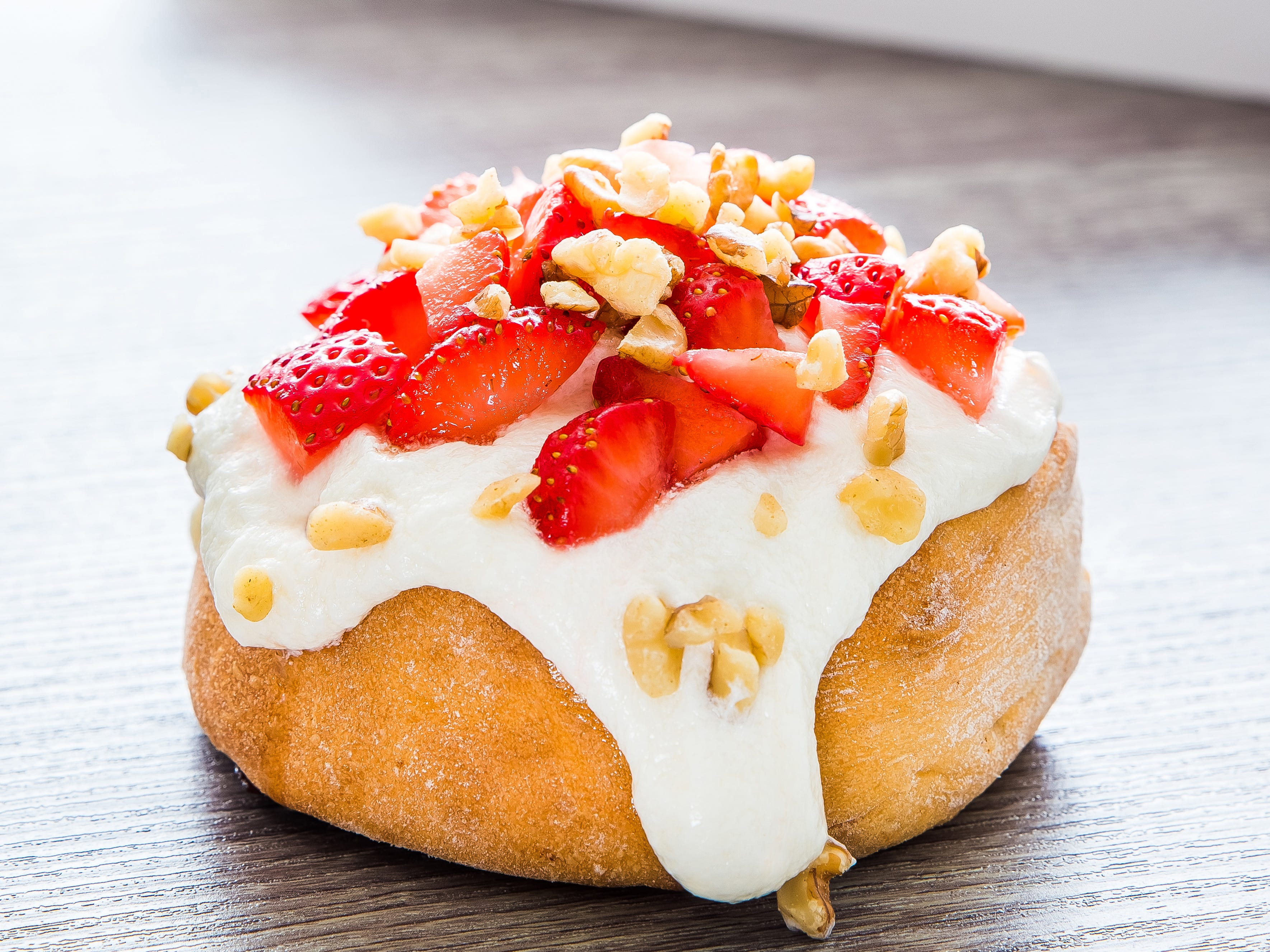 Cinnaholic's strawberries and cream cinnamon roll