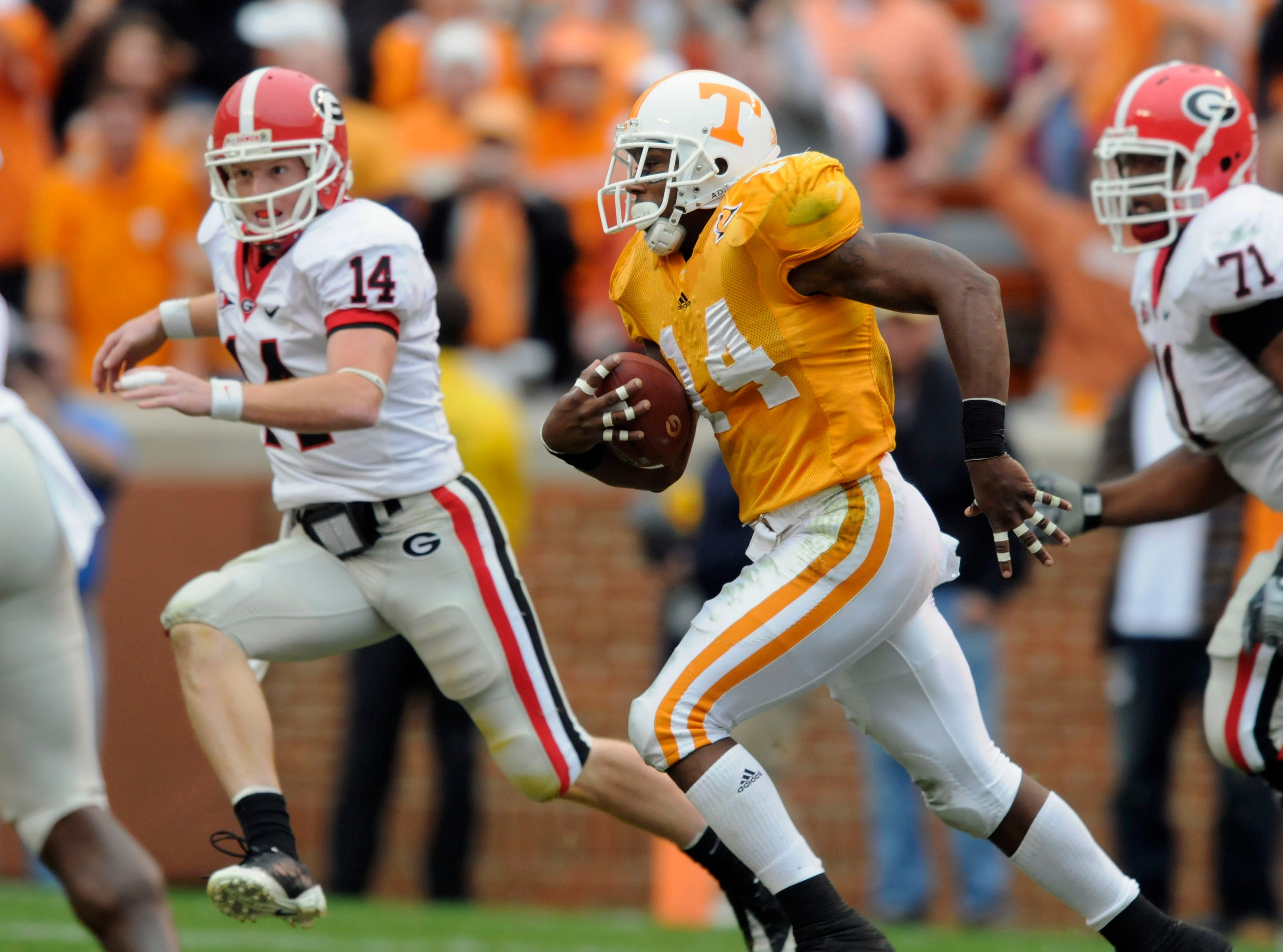 Tennessee cornerback Eric Berry (14) returns an interception/fumble return 46-yards with Georgia quarterback Joe Cox (14) and offensive tackle Cordy Glenn (71) in pursuit on Saturday, Oct. 10, 2009 at Neyland Stadium.Michael Patrick / Knoxville News Sentinel