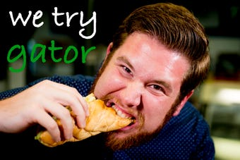 Urban life writer Ryan Wilusz takes part in a Tennessee tradition, eating alligator before the Tennessee-Florida game.
