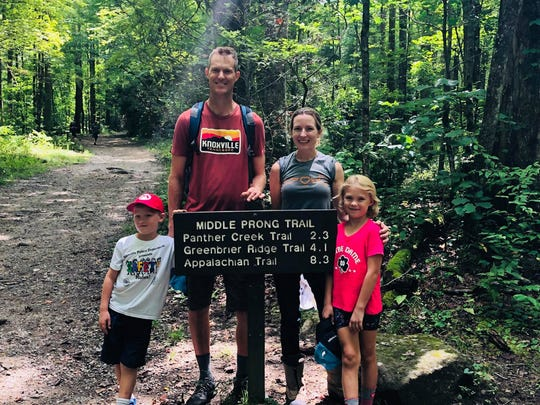 Brandon Bruce, founder of Cirrus Insight, and Tricia Bruce, associate professor at Maryville College, hike with their kids, Carson, 6, and Sonoma, 8.