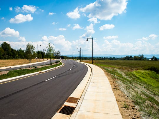 A view down Tesla Boulevard toward the Smoky Mountains at the Springbrook Farm Development in Alcoa on Thursday, September 20, 2018.
