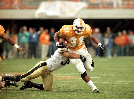 Tennessee's Jamal Lewis is grabbed by Vanderbilt's Carlton Hall in January 31, 1997. (Michael Patrick/News Sentinel)