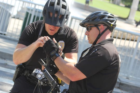 Officer Thomas Turner (left) helps Officer Steve Kaufman get a reading from the C3FT device following a demonstration at World's Fair Park on Sept. 20, 2018.