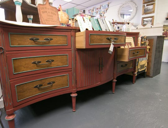 A refinished dresser by Julie Burke of Jewels in the Junkyard, shown Thursday, Sept. 20, 2018, is among the unique pieces offered at Heritage Home Accents and Decor.