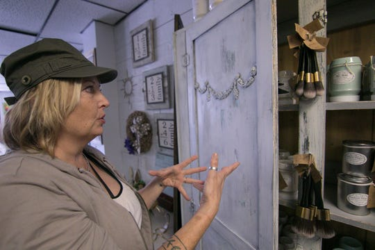 Trish Cooper talks at Heritage Home Accents and Decor Thursday, Sept. 20, 2018 about how milk paint, one of the types of paints she represents, gives a special look to refinishing pieces of furniture.