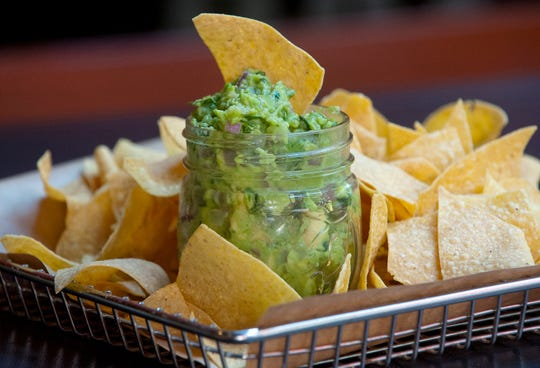 The Down One Bourbon Bar's grilled onion guacamole is made with fresh avocados, grilled onions,  jalape–o peppers, cilantro and lime and served with taco chips.September 20, 2018