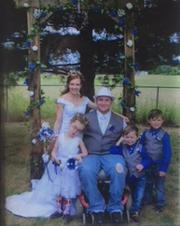 Elizabeth and Tyler Kuk on their wedding day, June 16, 2017 with Ashlie, Kamdyn and Ashton.