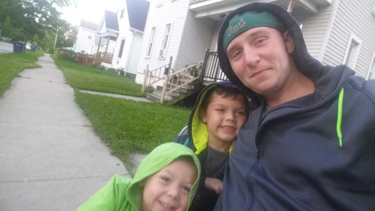 Tyler Kuk with sons Kamdyn and Ashton. The family was making plans to move to the Lansing area for a fresh start when an infection took Tyler Kuk's life Sept. 19, 2018.