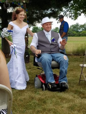 Elizabeth and Tyler Kuk at their June 16, 2017 wedding. The couple planned to  move to the Lansing area for a new start but he died Sept. 19, 2018 from an infection that started in a wound.