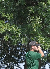 Madison's Jack Hatfield hits the ball during Thursday's Ohio Cardinal Conference golf tournament at Mohican Hills.