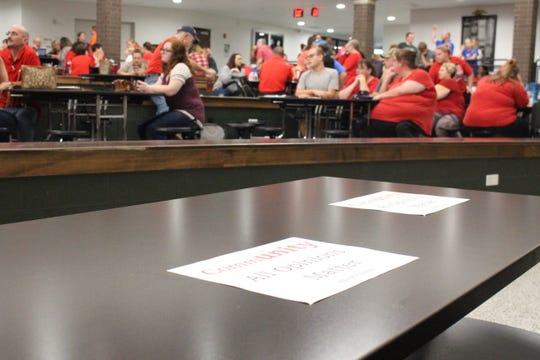 """A sign reading """"community,"""" """"All Opinions Matter"""" and """"#thisisOURplace sits on the school board table during a school board meeting Wednesday, Sept. 19, 2018. The board met in executive session for more than three hours but took no public actions."""