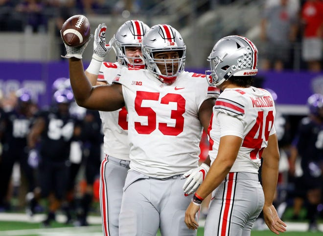 Ohio State defensive tackle Davon Hamilton celebrates his fumble recovery for a touchdown against TCU.
