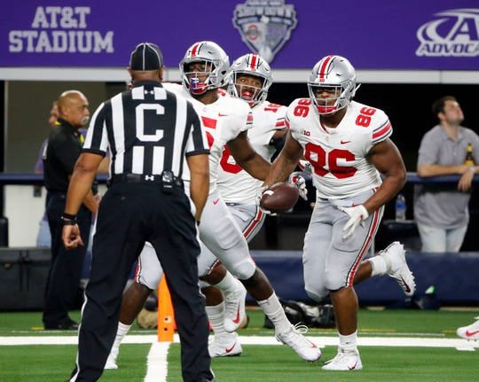 Ohio State defensive tackle Dre'Mont Jones scores on a 28-yard interception return to help spark a comeback in the 40-28 victory over TCU.