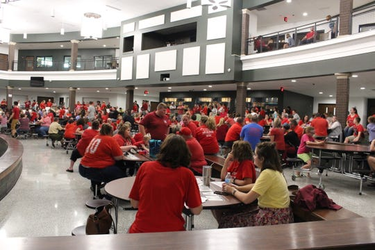 Hundreds of parents, community members and students, many wearing red, crowded into Madison Middle School for a school board meeting Wednesday, Sept. 19, 2018. The board met in executive session for more than three hours but took no public actions.