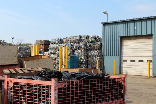 Bales of recycled material sit outside Sims Brothers Recycling, 1011 S. Prospect St.  The price of recycled material has dropped in recent years as China has enacted new policies that have flooded the markets.