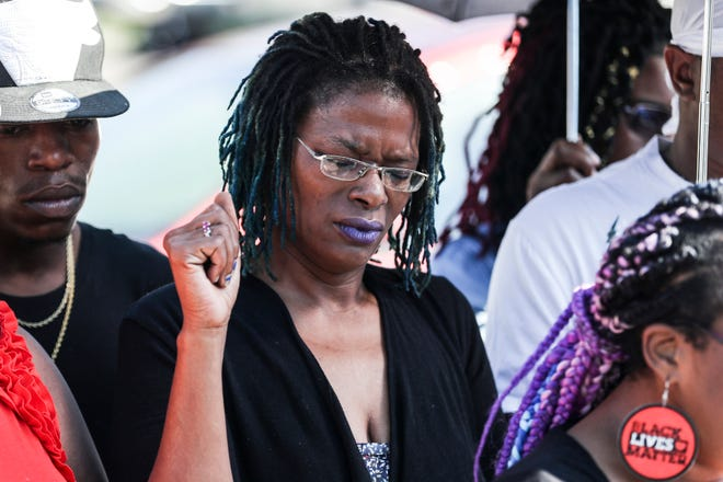 September 20 2018 - Janice Banks, the mother of Martavious Banks, the man who was shot by Memphis police officers, holds her fist in the air while Black Lives Matter activist Pamela Moses, not pictured, speaks during a press conference Thursday morning at the corner of Gill Street and Elvis Presley Boulevard.