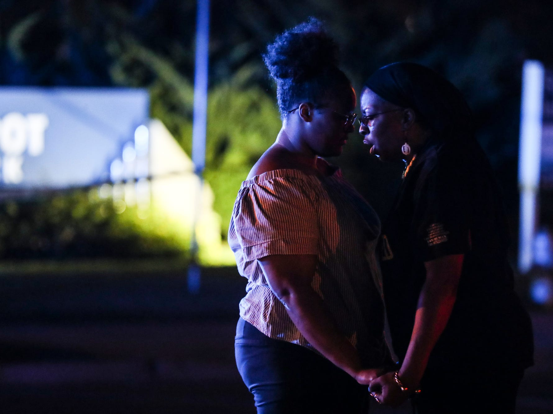 September 19 2018 - Britney Thornton, left, and Karen Spencer-McGee are seen along Airways Blvd. near the Memphis Police Department's Airways Station while protesting the officer-involved shooting of Martavious Banks. The protests came after news that officers involved in the shooting of Banks may have improperly switched off their dashboard or body cameras, or didn't turn them on.