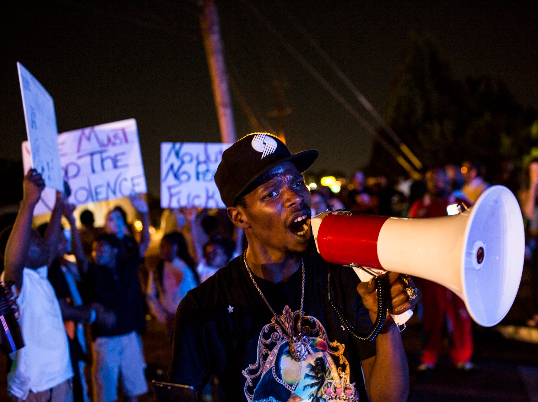 September 19 2018 - Mario Denton yells through a megaphone along Airways Blvd. near the Memphis Police Department's Airways Station while protesting the officer-involved shooting of Martavious Banks. The protests came after news that officers involved in the shooting of Banks may have improperly switched off their dashboard or body cameras, or didn't turn them on.