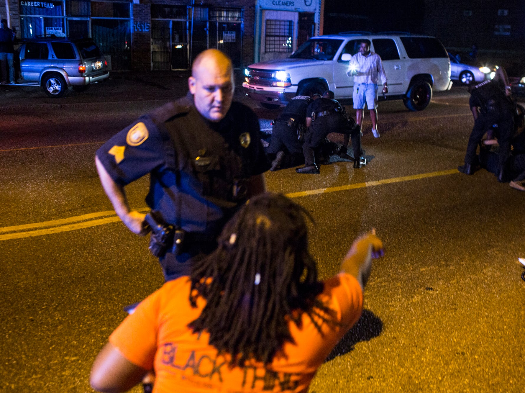 Memphis police officers arrest people along Elvis Presley Blvd. after protesters had shut down traffic along Elvis Presley Boulevard near the site of the police shooting of Martavious Banks on Sept. 19. The protests followed news that officers involved in the shooting of Banks may have improperly switched off their dashboard or body cameras, or didn't turn them on.