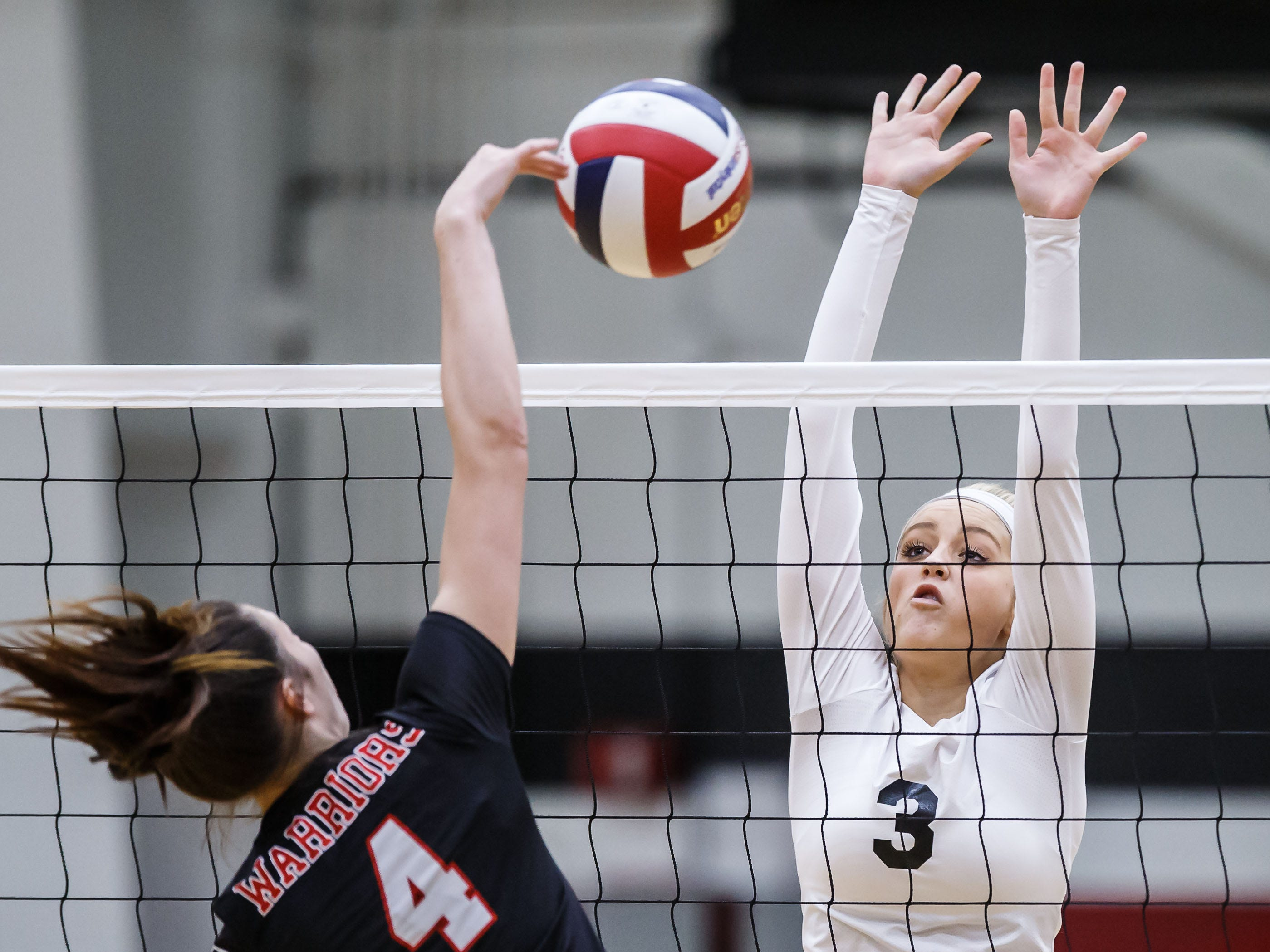 Waukesha South senior Molly Posta (3) faces Muskego's Anastasia Dowd (4) at the net in Waukesha on Tuesday, Sept. 18, 2018.