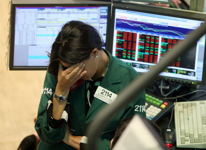 Elizabeth Rose, a specialist with Lehman Brothers MarketMakers, works on the trading floor of the New York Stock Exchange on Sept. 15, 2008. Home prices had sunk, and foreclosure notices began arriving. Layoffs began to spike. Tremors intensified as Lehman Brothers, a titan of Wall Street, slid into bankruptcy on Sept. 15, 2008. Thefinancialcrisis touched off the worst recession since the 1930s Great Depression.