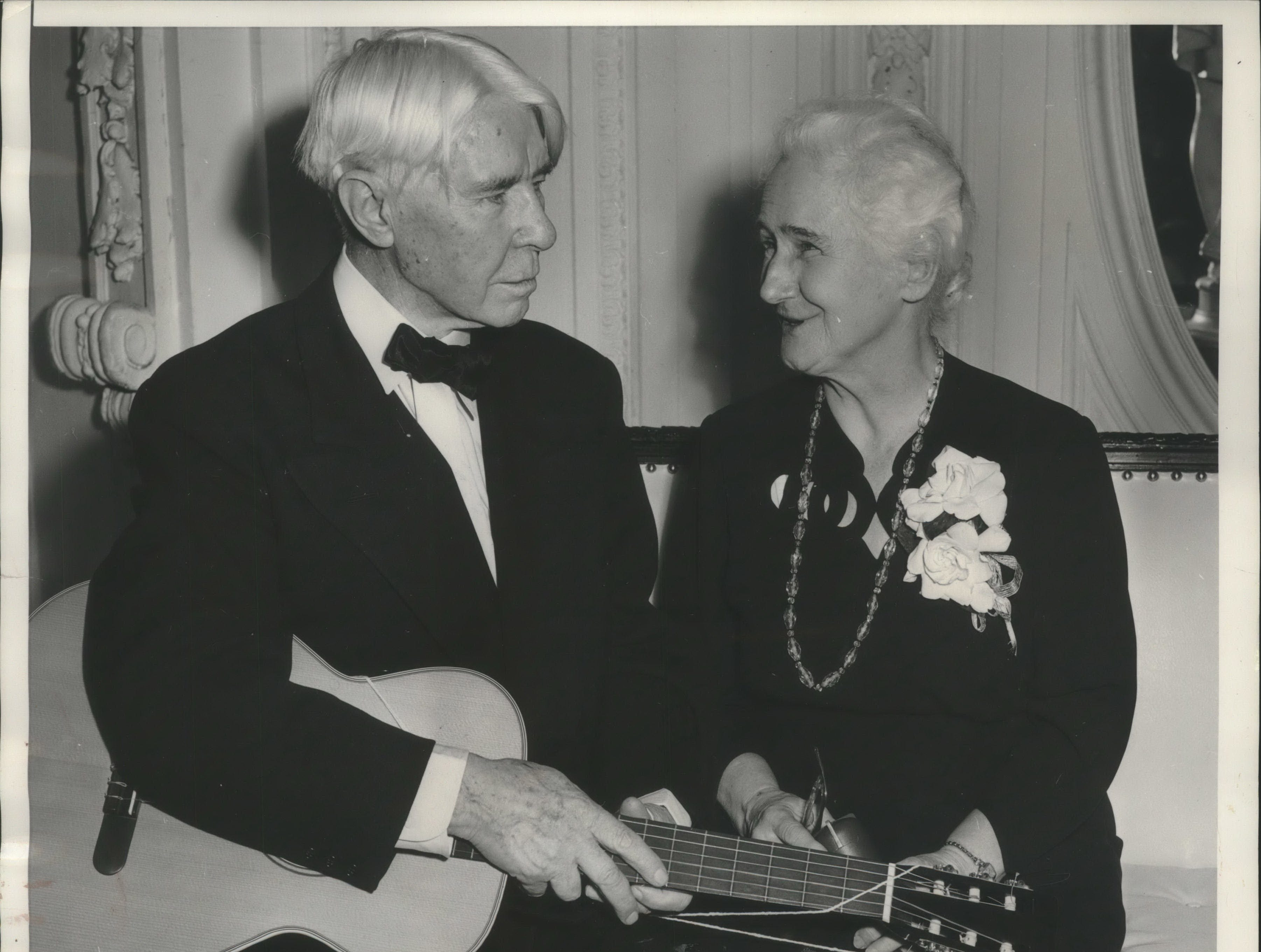 Poet and historian Carl Sandburg entertains his wife Lilian at a dinner celebrating his 75th birthday in Chicago.