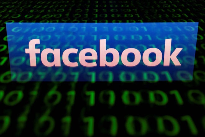 """(FILES)  A file illustration picture taken on April 28, 2018 shows the logo of social network Facebook displayed on a screen and reflected on a tablet in Paris. - A complaint has been filed with the US government accusing Facebook and 10 other companies of using the platform's job ad targeting system to discriminate on the basis of gender. The complaint was announced September 18, 2018 by the American Civil Liberties Union, a union called the Communications Workers of America and a labor law firm, on behalf of three female job seekers and a group of """"thousands"""" of members represented by the union. (Photo by Lionel BONAVENTURE / AFP)LIONEL BONAVENTURE/AFP/Getty Images"""