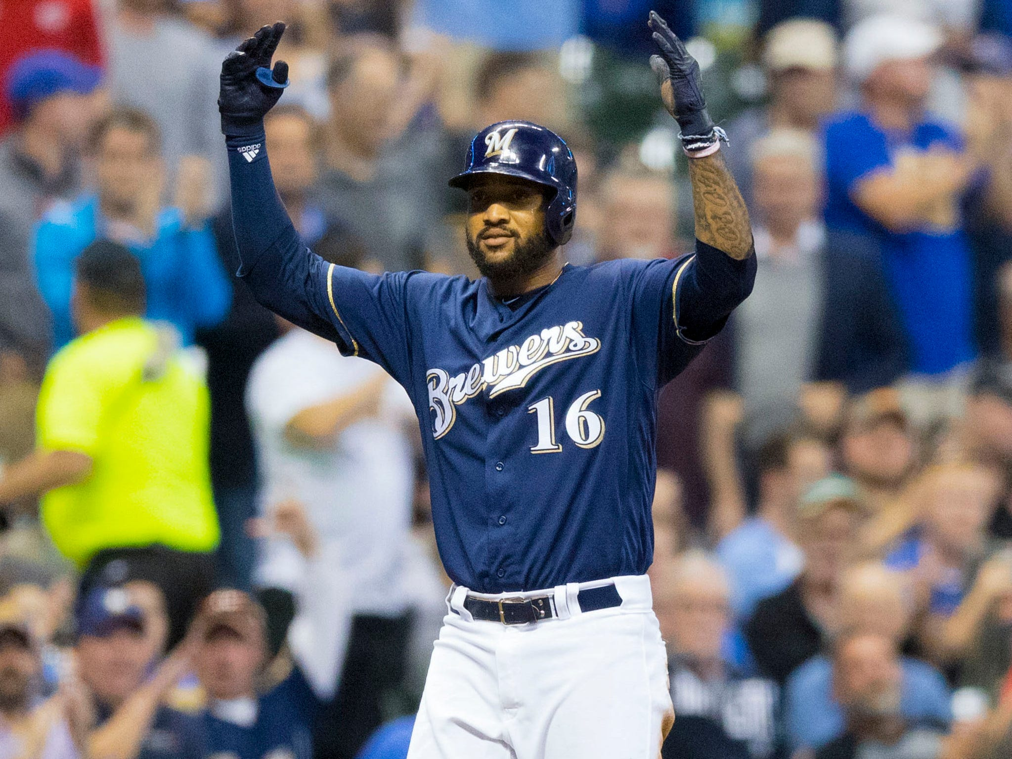 Brewers rightfielder Domingo Santana gestures toward the Brewers dugout  after tripling in the sixth inning against the Reds on Wednesday night.