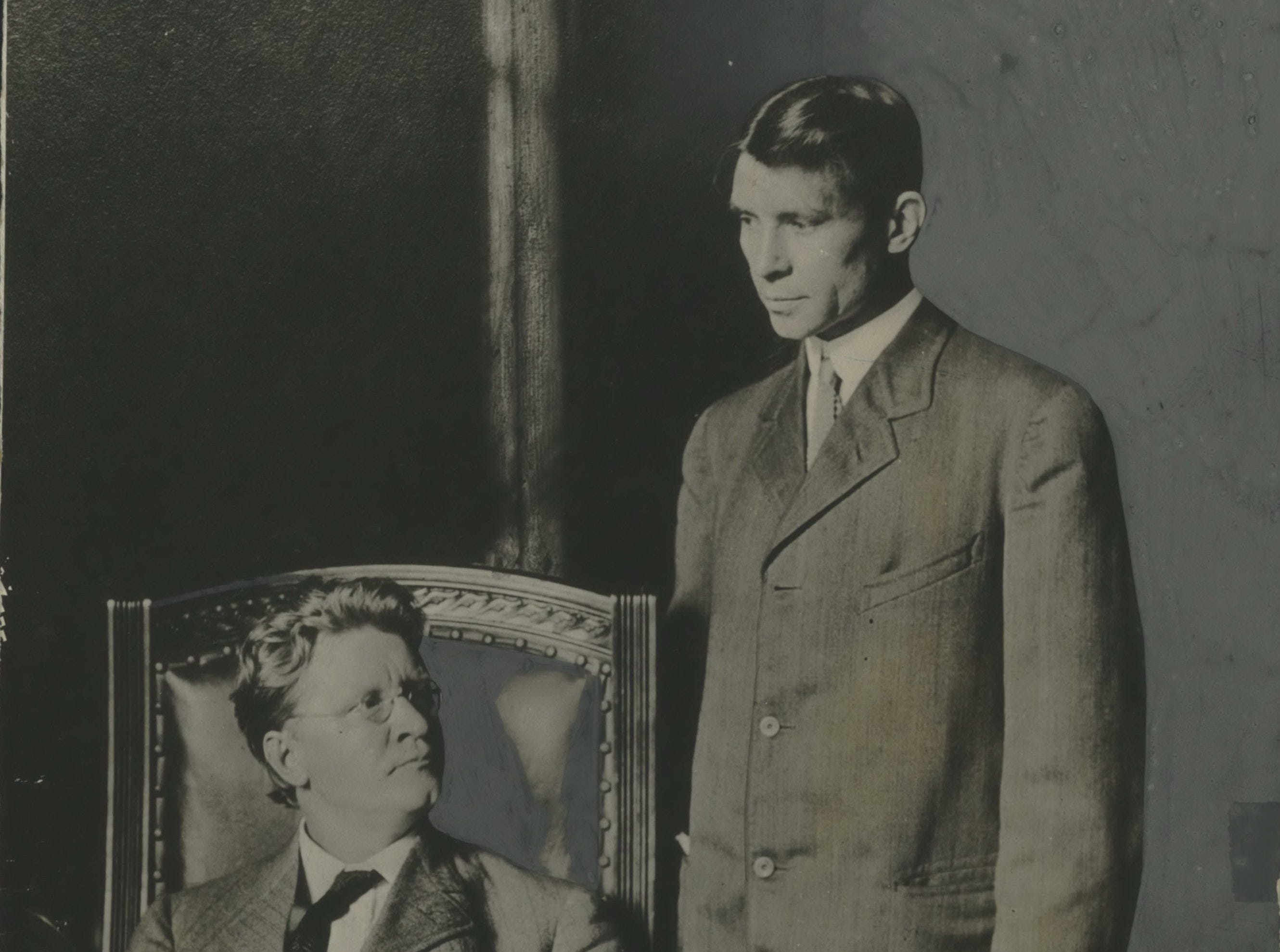 Carl Sandburg is shown in 1910 standing beside Emil Seidel, Milwaukee's first Socialist mayor. After Seidel's victory, Sandburg worked for him.