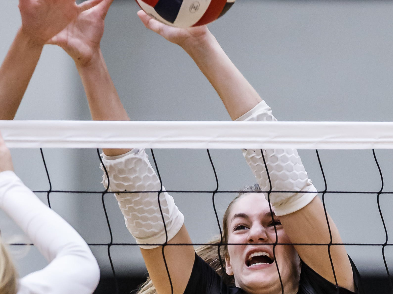 Muskego freshman Brooke Porter (12) blocks at the net during the match at Waukesha South on Tuesday, Sept. 18, 2018.