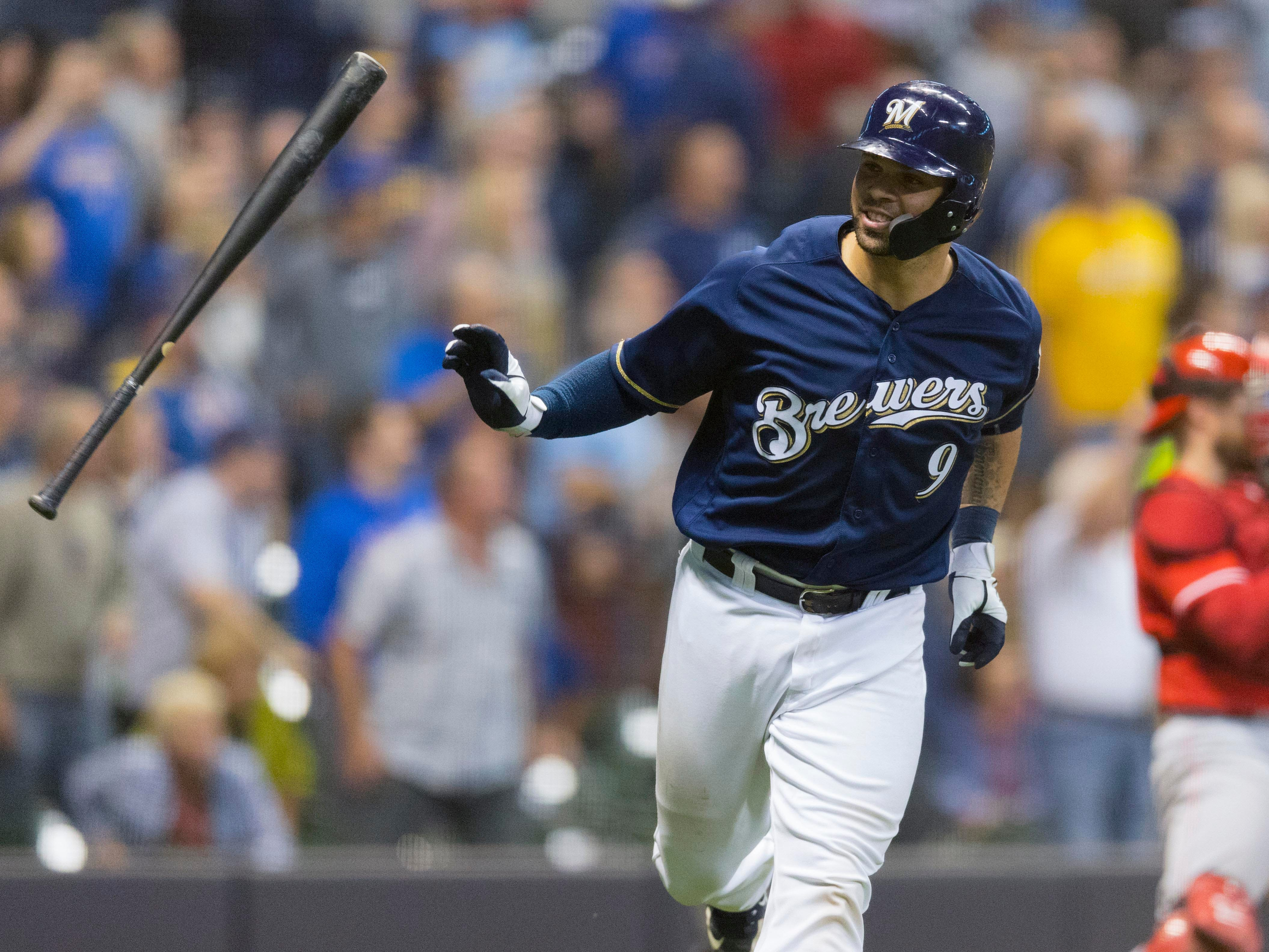 Manny Pina flips his bat aside as he begins his tour around the bases for his three-run homer in the sixth inning after a 13-pitch battle with Reds starting pitcher Matt Harvey on Wednesday night.