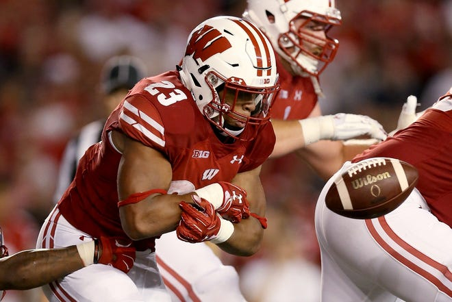 UW tailback Jonathan Taylor fumbled twice in the Badgers' first two games but now has gone 48 carries without giving up the ball.