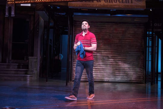 "Ryan Alvarado reflects on the neighborhood during ""In the Heights"" perform at the Milwaukee Repertory Theater's Quadracci Powerhouse."