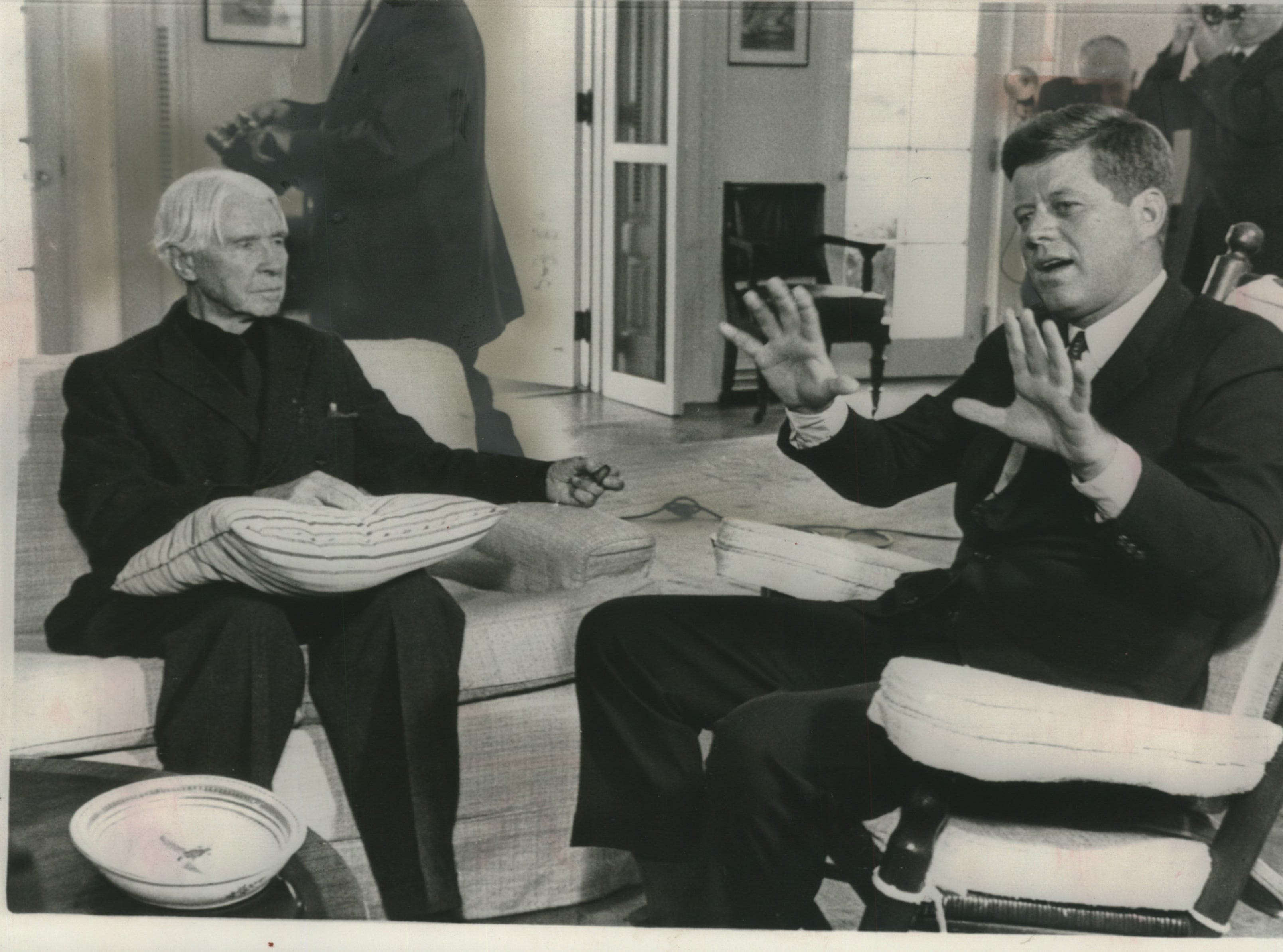 Poet Carl Sandburg held a pillow in his lap when he visited President Kennedy at the White House Wednesday. Sandburg was in Washington to speak at the opening of a Civil war centennial exhibit. President Kennedy And Others - A.