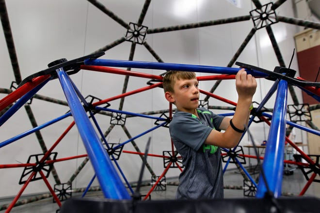 Josh Larsen of Franklin works in the geodesic dome at the 2017 Maker Faire at State Fair Park.