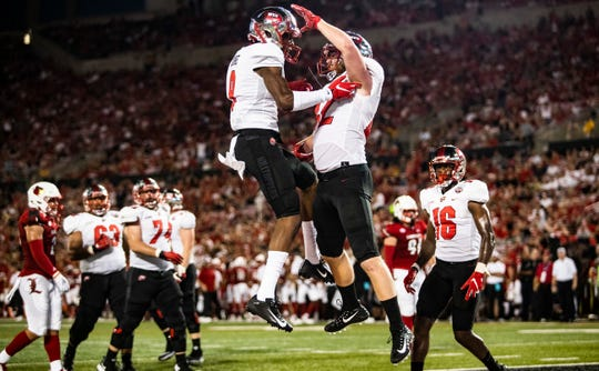 Western Kentucky wide receiver Xavier Lane (9) of Montgomery's G.W. Carver celebrates with tight end Kyle Fourtenbary (42) of Opelika after Fourtenbary's touchdown against Louisville on Sept. 15.