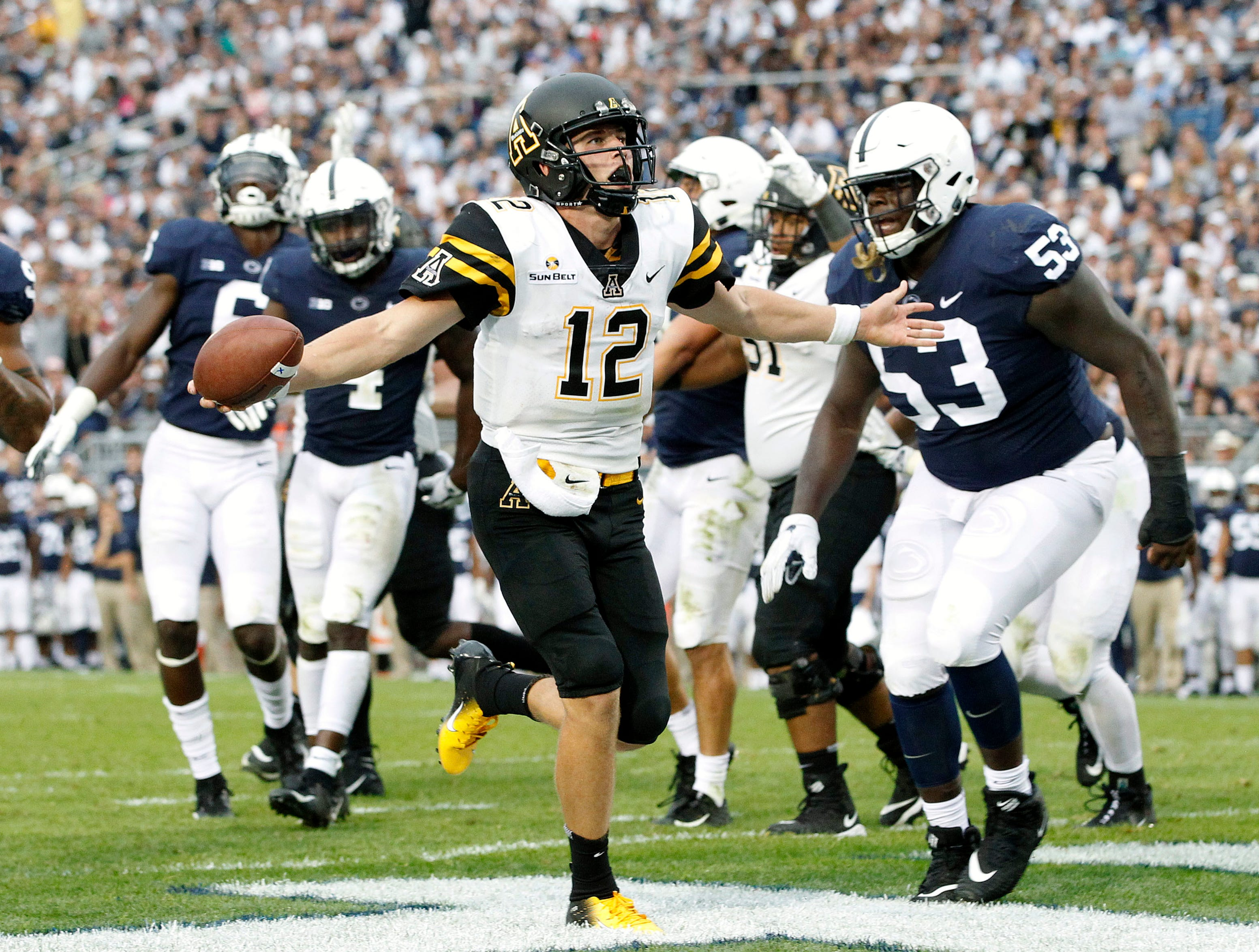 Appalachian State quarterback Zac Thomas, scoring against Penn State on Sept. 1, is one of eight players from Hewitt-Trussville.