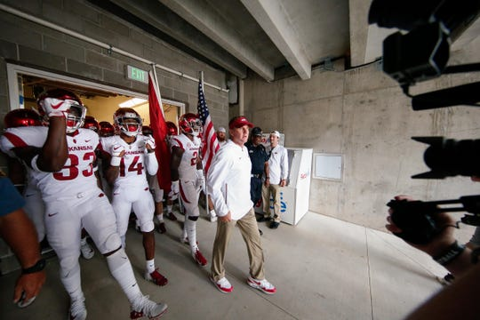 Arkansas head coach Chad Morris gets ready to lead players onto the field before a game against Colorado State on Saturday, Sept. 8, 2018, in Fort Collins, CO.