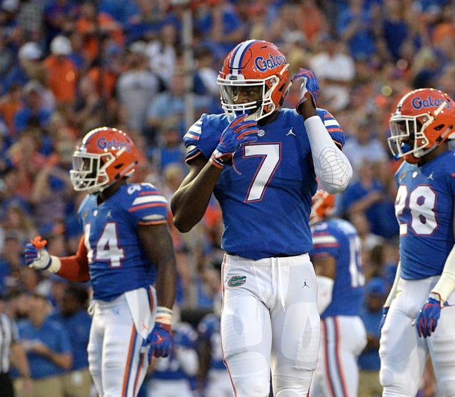 Florida linebacker Jeremiah Moon is one of 14 players from Hoover on major college rosters this season.