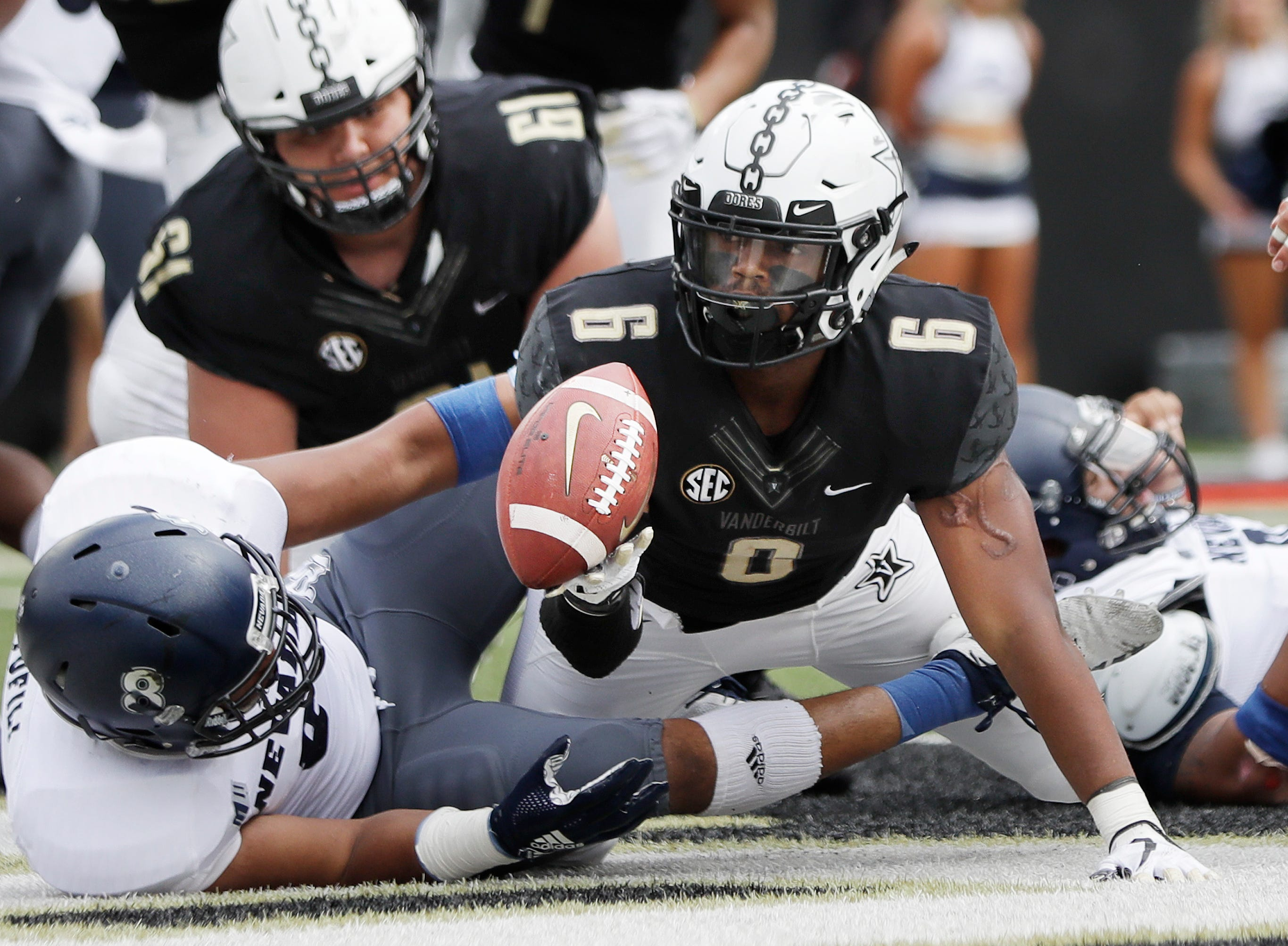 Vanderbilt running back Josh Crawford, who is an Edgewood graduate, tosses the ball away after scoring a touchdown against Nevada on Sept. 8.
