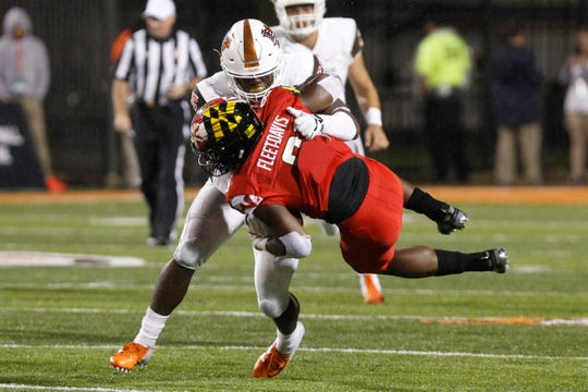 Bowling Green's Kholbe Coleman of Hoover tackles Maryland's Tayon Fleet-Davis on Sept. 8.