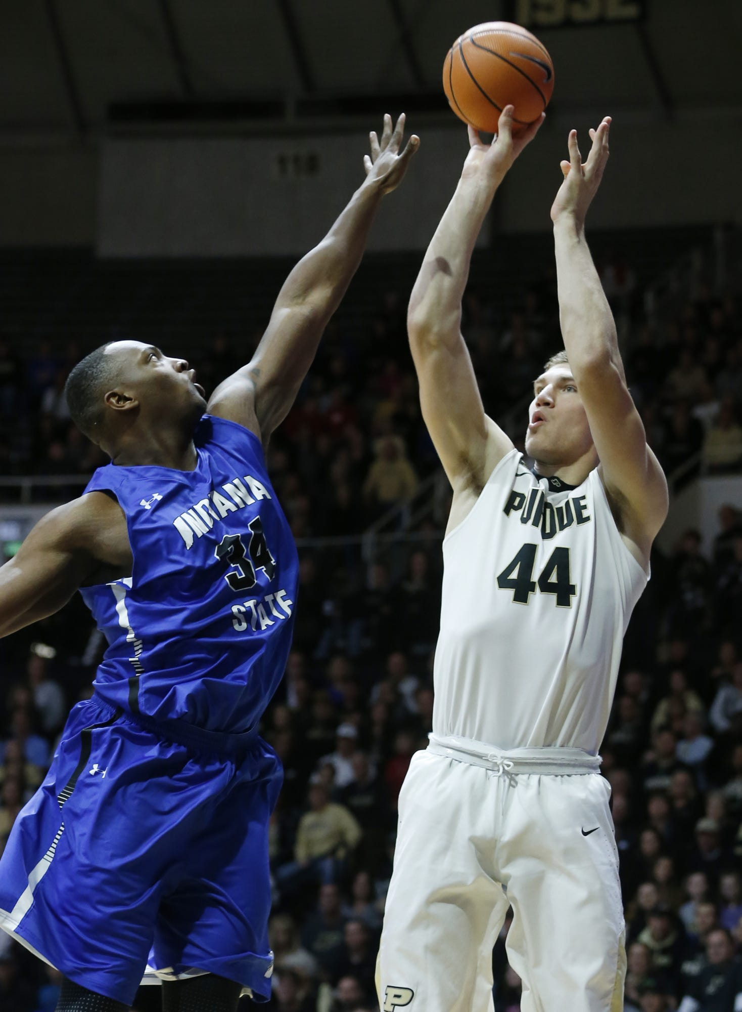 "Indiana State's Brandon Murphy of G.W. Carver tries to block a shot of Purdue's Isaac Haas of Hokes Bluff last season. After four years of college basketball, Murphy, known as ""Big Baby"" when he was at Carver, is now trying football at Memphis."